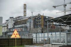 Chernobyl power station, 4-th block. Chernobyl nuclear power station, 4-th block with warning sign Royalty Free Stock Images