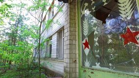 Chernobyl Pripyat Abandoned Police station and broken doors stock footage