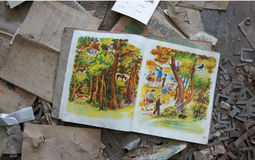 Chernobyl School Book. School book that was left behind on the floor of an abandoned schoolhouse Pripyat City in the Chernobyl Isolation Zone, Ukraine, after the Stock Photos