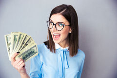 Cherrful businesswoman holding bill of dollars Royalty Free Stock Image