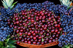 Cherrie and black grape Stock Photos