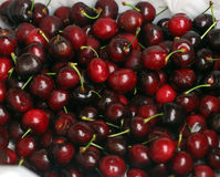 Cherries. Close up of a box of cherries for sale in a fruit market Stock Photography