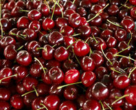 Cherries. Heap of red cherries on a market stand Stock Photo