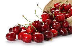 Cherries. Spilling out from the bowl Stock Photos