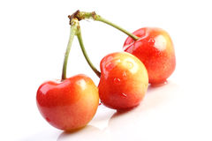 Cherries. Three cherries on white background Stock Photos