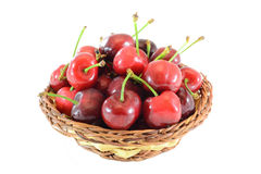Cherries. Fresh cherries in a wicker basket, isolated on white background Royalty Free Stock Photo