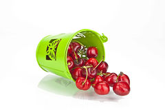 Cherries. Fresh red cherries in a green bowl on white background Stock Photography