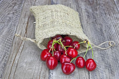 Cherries. Fresh red cherries in a jute sack Royalty Free Stock Images