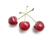 Cherries. Isolated big red three cherries close-up without background Royalty Free Stock Photo