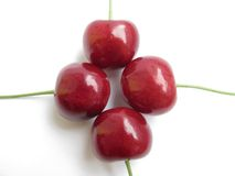 Cherries. Sweet close-up in cross form on white background Royalty Free Stock Photography