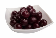Cherries. Some red cherries in the white plate royalty free stock photography