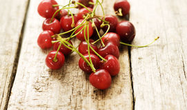 Cherries. On a wooden  table Royalty Free Stock Image