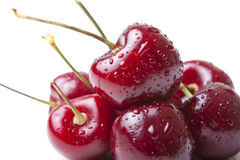 Cherries. Stack of red delicious fresh cherries  on white background Stock Image
