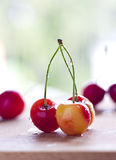 Cherries. Closeup of cherries in the kitchen over wooden board Royalty Free Stock Image