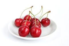 Cherries. On dish stock photography