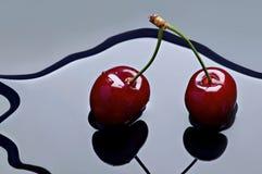 Cherries. Two cherries on mirror water Royalty Free Stock Photo