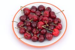 Cherries. On a plate Stock Photos
