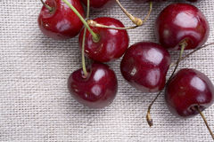 Cherries from Above. Overhead view of some cherries sitting on a muslin surface. Will work as a vertical or horizontal Royalty Free Stock Photos