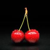 Cherries against black background. Cherries with water drops on them against black background Stock Images