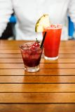 Cherries alcoholic cocktail and exotic non-alcoholic cocktail Stock Photography