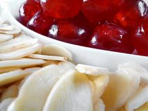 Cherries and Almonds. A bowl of glace cherries accompanied by slivered almonds Royalty Free Stock Photo