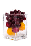 Cherries, apricots and plums in glass on white background.  Royalty Free Stock Photography