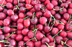 Cherries background. Background of the red cherries with stem Royalty Free Stock Images