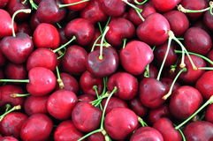 Cherries background. Background of the red cherries with stem Royalty Free Stock Photo