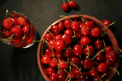 Cherries in basket. On balck background royalty free stock images