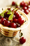 Cherries in basket Stock Photo