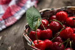 Cherries in basket with water drops Royalty Free Stock Photos