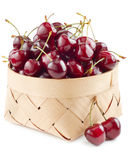 Cherries in basket on white Stock Photography