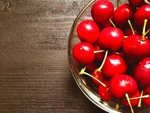 Fresh organic red cherries with stems  Royalty Free Stock Images