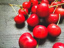 Fresh organic red cherries with stems close up Stock Image