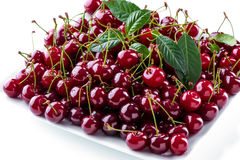 Cherries berries on square plate close-up Stock Photos
