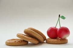Cherries with biscuits Stock Images
