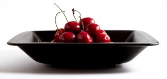 Cherries in black bowl Stock Photo