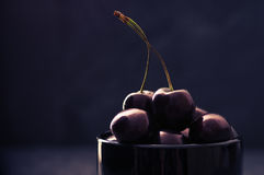 Cherries in black bowl Royalty Free Stock Images