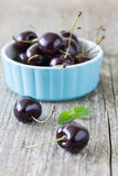 Cherries in a blue bowl royalty free stock image