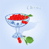 Cherries in a blue cup vector Royalty Free Stock Photo