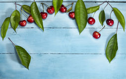 Cherries on a blue wooden background. Top view. Cherries on a blue wooden background.Top view with copy space stock photography
