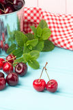 Cherries in blue wooden table Stock Image