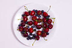 Cherries and blueberries Stock Photos
