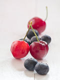 Cherries and blueberries Royalty Free Stock Images