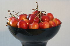Cherries in a bowl. Cherries in a black bowl royalty free stock photos