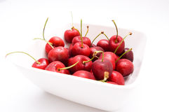 Cherries in bowl Stock Images