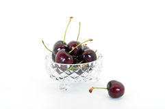 Cherries in bowl. Cherries in crystal bowl isolated on white Stock Image