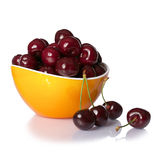 Cherries in bowl close up isolated on white background. Royalty Free Stock Image