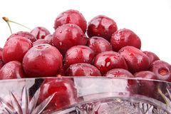 Cherries in a bowl. isolated on white background Stock Photos