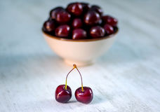 Cherries in bowl and near Royalty Free Stock Photo